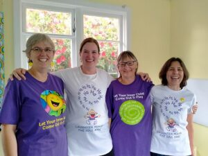 People from Laughter Yoga Upper Hutt modelling the Laughter Yoga t-shirts